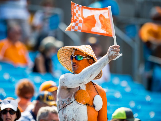 A spirited Tennessee fan waves a flag before the Tennessee Volunteers' game against West Virginia in the Belk College Kickoff at Bank of America Stadium in Charlotte, N.C., on Saturday, Sept. 1, 2018.