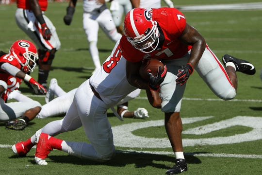 Georgia running back D'Andre Swift (7) drives in for a touchdown during the first half of an NCAA college football game against Austin Peay in Athens, Ga., Saturday, Sep 1, 2018.