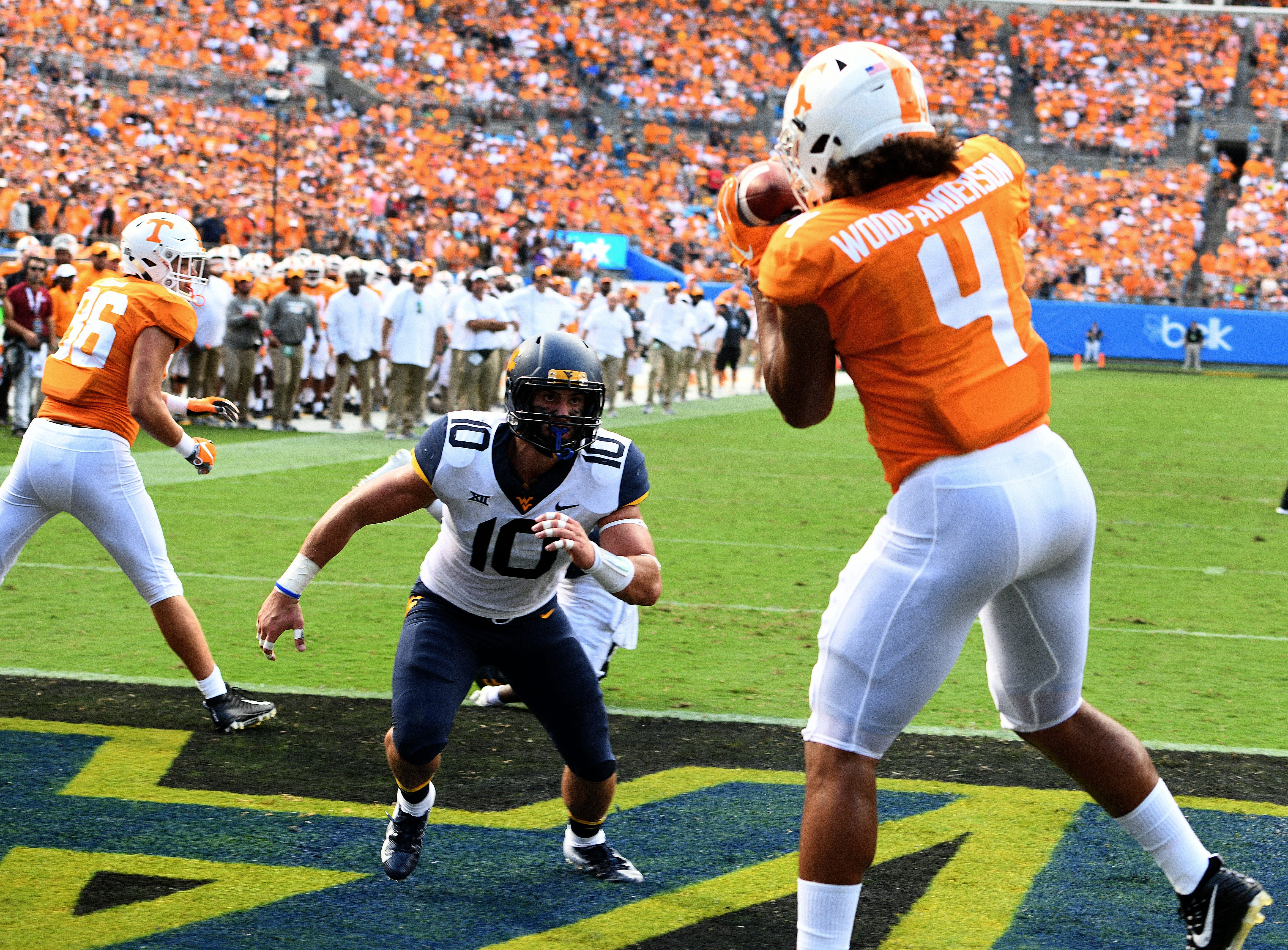Tennessee tight end Dominick Wood-Anderson (4) scores a touchdown during first half action against the West Virginia Mourtaineers in the Belk College Kickoff game in Charlotte, NC Saturday, September 1, 2018.