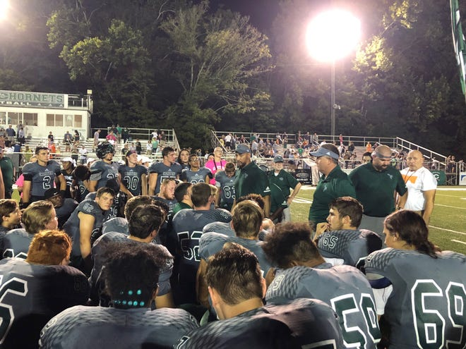 Carter head coach Vic Wharton talks to his team following its 14-0 win over Seymour on Friday, Aug. 31, 2018.