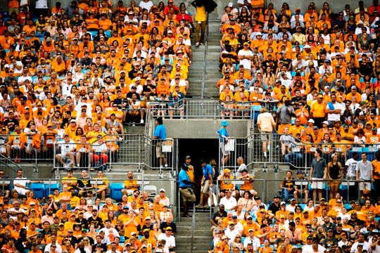 Tennessee fans watch from the stands during the Belk College Kickoff between Tennessee and West Virginia at Bank of America Stadium in Charlotte, North Carolina on Saturday, September 1, 2018.