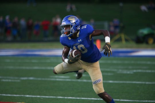 Karns' Thomas Harper comes down with the ball during the Karns versus West high school football game at Karns high school Friday Aug. 31, 2018.