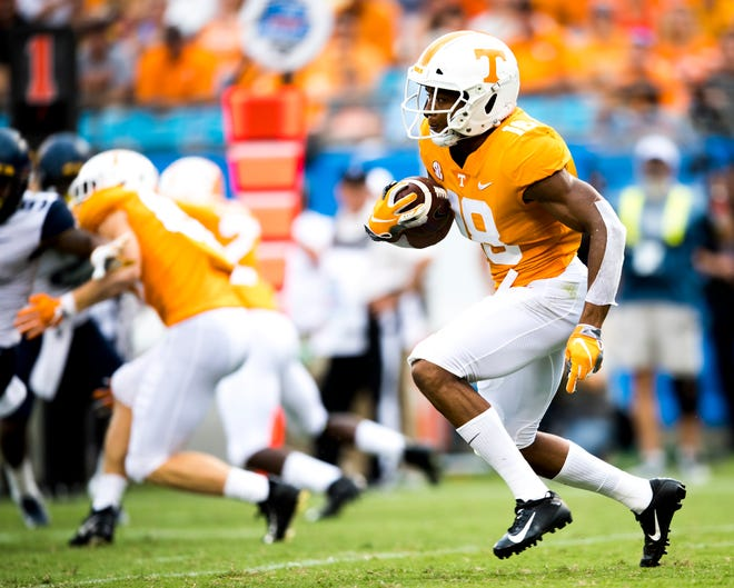Tennessee defensive back Nigel Warrior (18) runs the ball down the field during the Belk College Kickoff between Tennessee and West Virginia at Bank of America Stadium in Charlotte, North Carolina on Saturday, September 1, 2018.