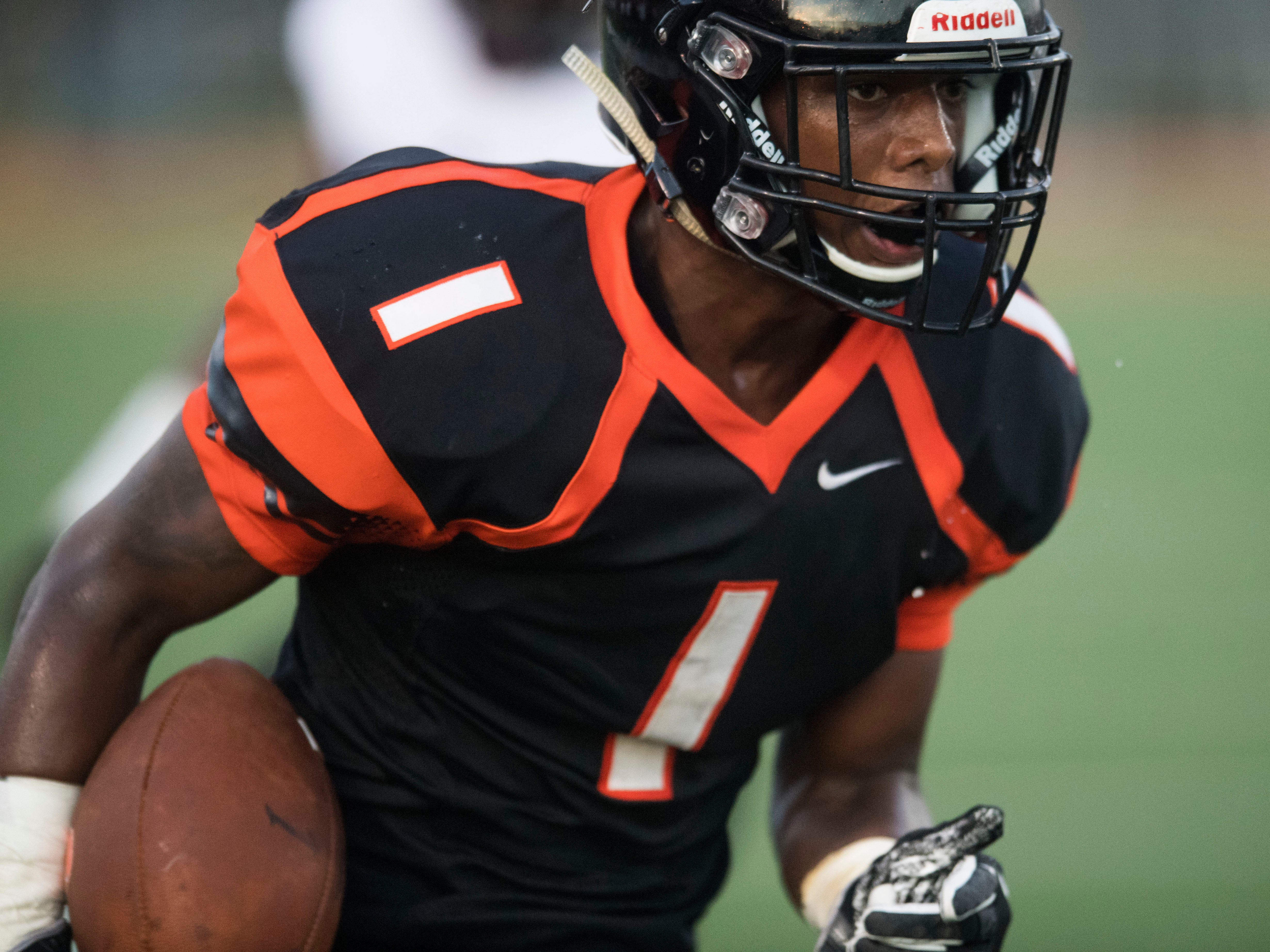 Powell's Fernando Frances (1) on a touchdown run in the football game against Fulton on Friday, Aug. 31, 2018.