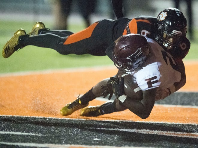 Fulton's JaShaun Fenderson (2) makes a touchdown reception under guard from Powell's Riley Bryant (6) during the football game at Powell on Friday, August 31, 2018.