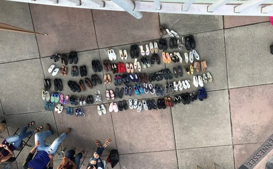 Rows of shoes at International Overdose Awareness Day at Volunteer Landing represent those who died of overdose.