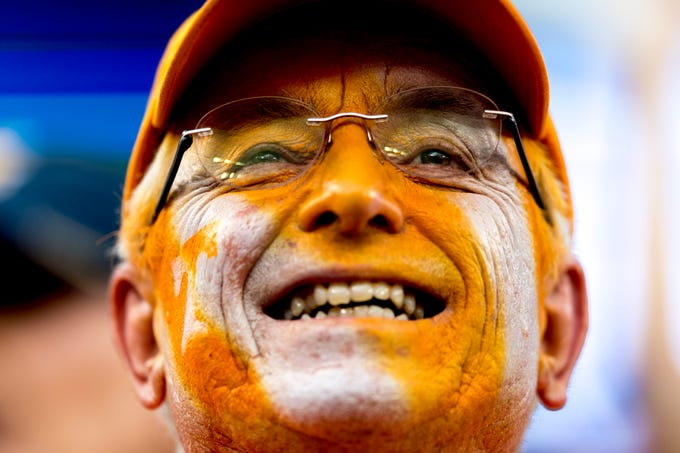 Tennessee fan Steven Miracle watches the Vols play during the Belk College Kickoff between Tennessee and West Virginia at Bank of America Stadium in Charlotte, N.C., on Sept. 1, 2018.