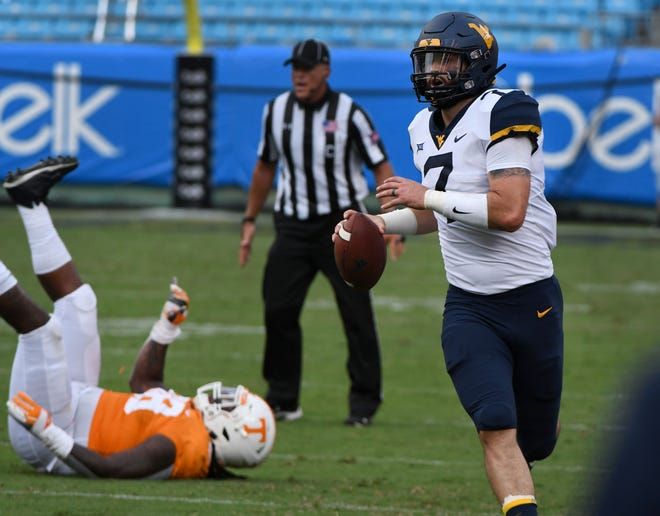 West Virginia quarterback Will Grier (7) during action against Tennessee in the Belk College Kickoff game in Charlotte, NC Saturday, September 1, 2018.