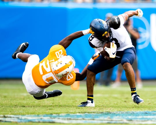 Tennessee defensive back Bryce Thompson (20) defends against West Virginia wide receiver Marcus Simms (8) during the Belk College Kickoff between Tennessee and West Virginia at Bank of America Stadium in Charlotte, North Carolina on Saturday, September 1, 2018.