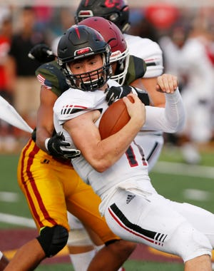Lafayette Jeff quarterback Maximus Grimes is brought down after a carry against McCutcheon Friday night.