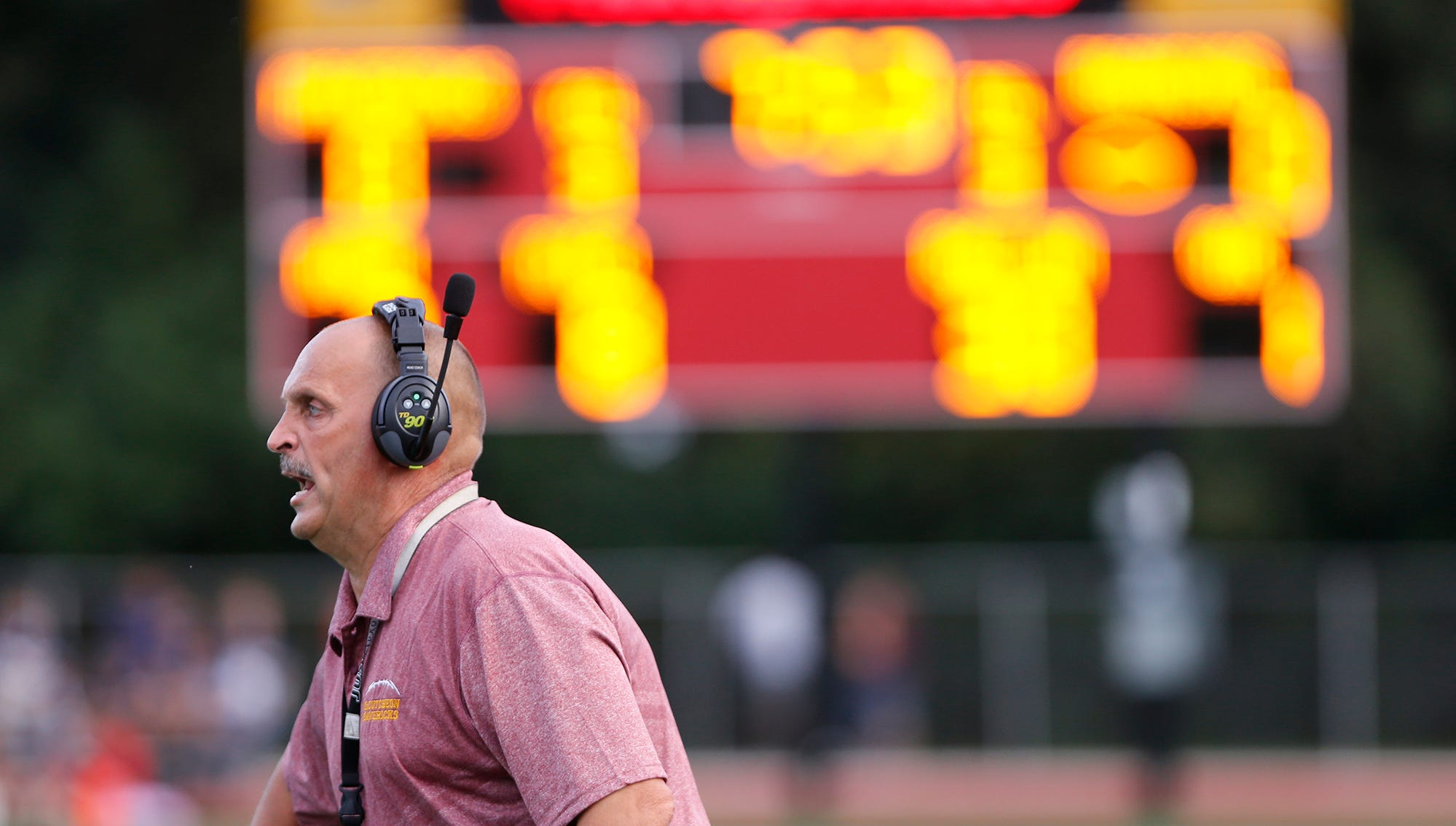 McCutcheon head coach Ken Frauhiger shouts instructions to the Mavericks as they face Lafayette Jeff Friday, August 31, 2018, in Lafayette. Jeff pounded McCutcheon 48-7.