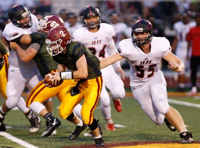 Lafayette Jeff defensive end Jared Nault chases down McCutcheon quarterback Peyton Williams.