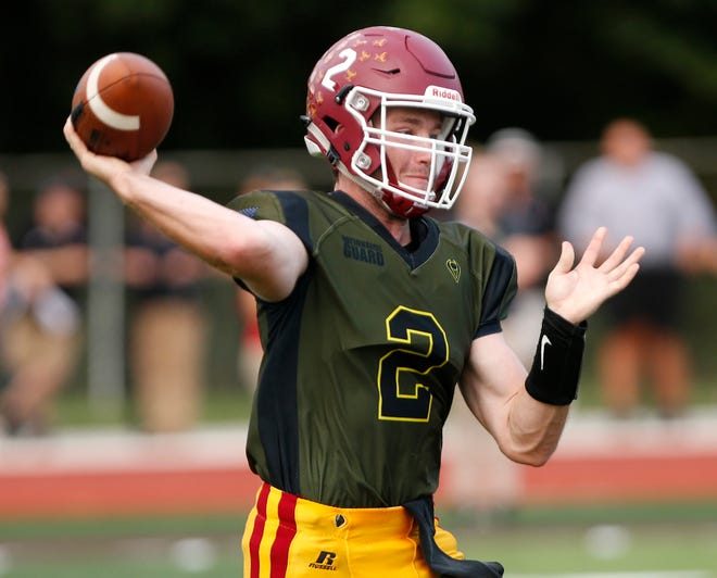 Quarterback Peyton Williams of McCutcheon with a pass against Lafayette Jeff in the first half Friday, August 31, 2018, in Lafayette. Jeff pounded McCutcheon 48-7.