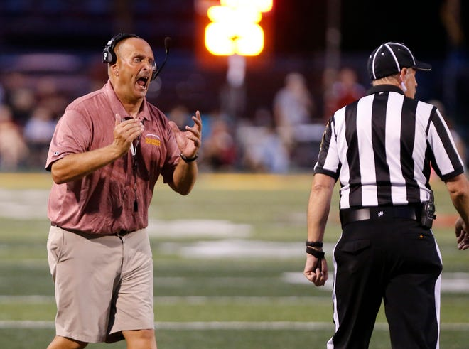McCutcheon head coach Ken Frauhiger with words for an official as the Mavericks struggle against Lafayette Jeff Friday, August 31, 2018, in Lafayette. Jeff pounded McCutcheon 48-7.