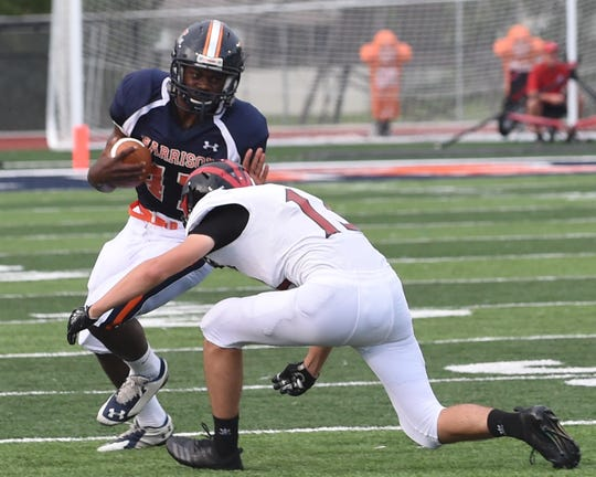 Harrison fullback Omarion Dixon helped the Raiders wear down Logansport in the second half of a 45-21 victory at A.J. Rickard Field.