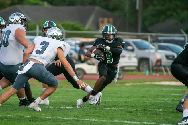 St. Thomas More's Gregory Mahtook (3), shown here preparing to bring down Lafayette High's John Simmons, is the long returning starter for the Cougars' defense this season.