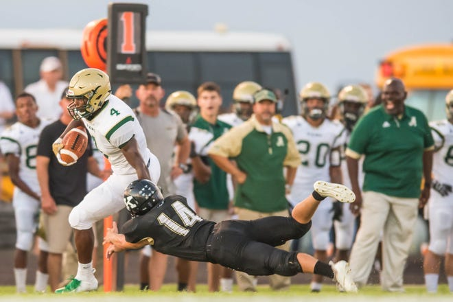 Jeremiah Brooks (4) for Acadiana gets to the outside for the first down as the Kaplan Pirates host the Acadiana Wreckin' Rams on Friday night Aug.31, 2018.