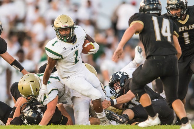 Acadiana's Dillan Monette (1) rushed for 166 yards and two touchdowns before leaving the game with cramping issues.