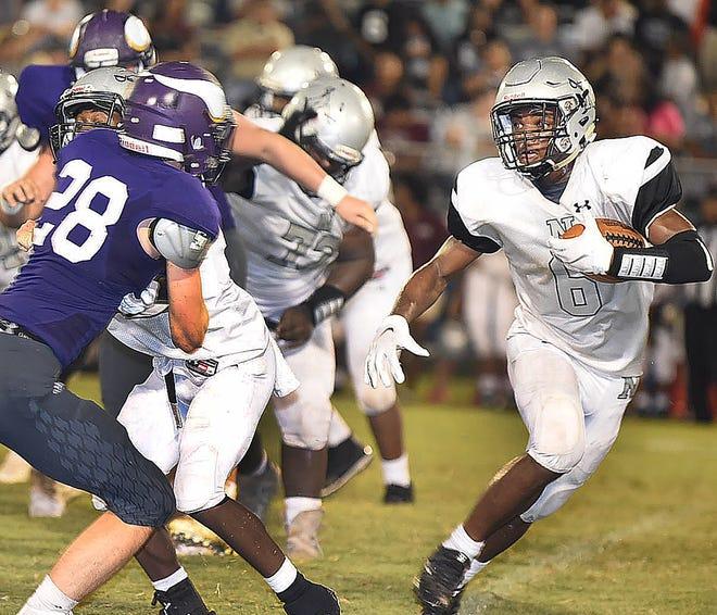 Northwest High's Mekhi Hammond (6) runs the ball against the Opelousas Catholic Vikings during the Raiders' season opener Thursday.