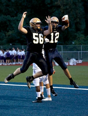 Lancaster's Nate Weber and Casey Finck celebrate after Finck scored on a 32-yard touchdown pass last week against DeSales. Lancaster will travel to face Hilliard Darby on Friday at 7 p.m.