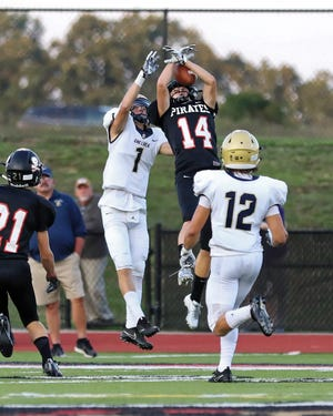 Pinckney's Ryan Hanifan pulls down an interception in the Pirates' 31-14 loss to Chelsea on Friday Aug. 31, 2018 .
