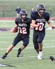 Quarterback Joe Bona (12) follows the blocking of running back Ethan Stinson (10) to gain some of his 81 yards on 17 carries in a 31-14 loss to Chelsea on Friday, Aug. 31, 2018.