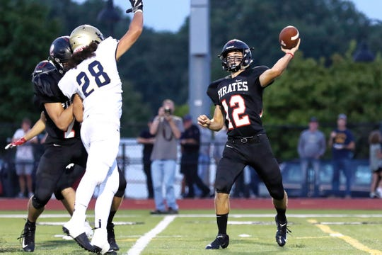 Pinckney's Joe Bona throws a pass while Chelsea's Nehemiah Mite tries to bat it down on Friday, Aug. 31, 2018.