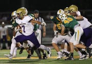 Vito Tisdale runs with the ball against St. Xavier.