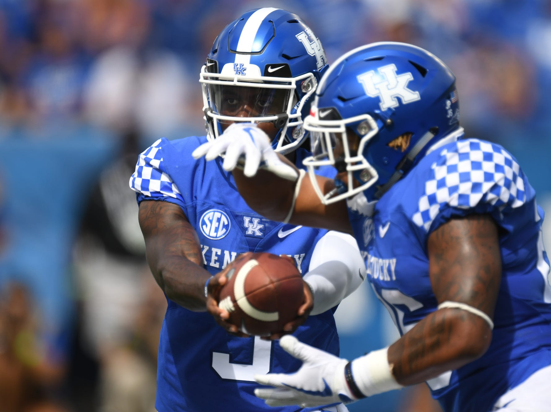 UK QB Terry Wilson hands off the ball to RB Benny Snell Jr. during the University of Kentucky football game against Central Michigan at Kroger Field in Lexington, Kentucky on Saturday, September 1, 2018.