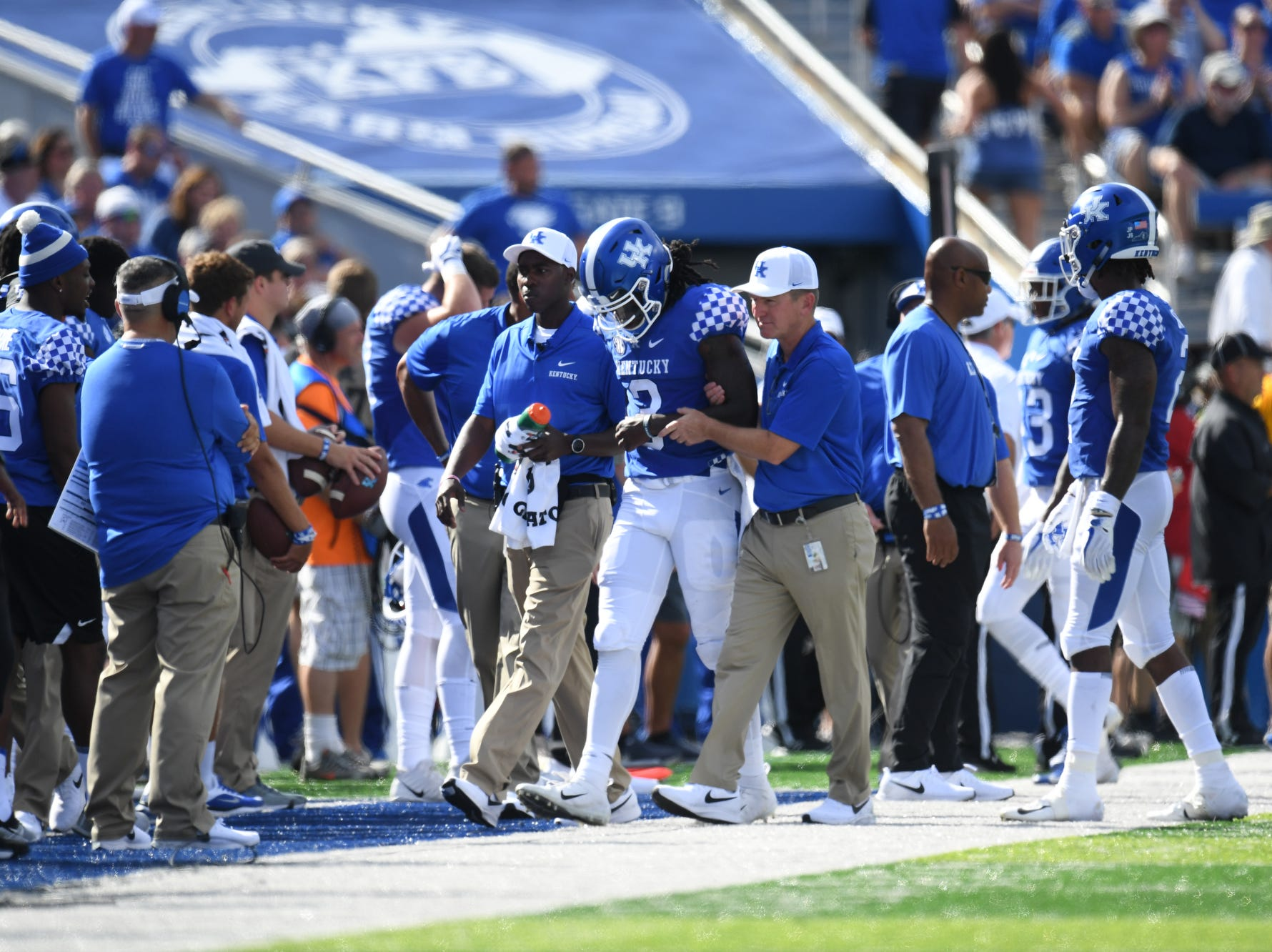 UK QB Terry Wilson is injured and walks off the field during the University of Kentucky football game against Central Michigan at Kroger Field in Lexington, Kentucky on Saturday, September 1, 2018.