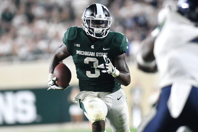 MSU senior running back LJ Scott rushed for 84 yards on 23 carries in Week 1, often slamming into a wall of defenders at the line of scrimmage.
