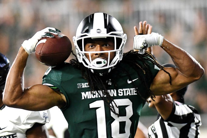 Michigan State's Felton Davis III celebrates after scoring on a two-point conversion during the fourth quarter on Friday, Aug. 31, 2018, at Spartan Stadium in East Lansing.