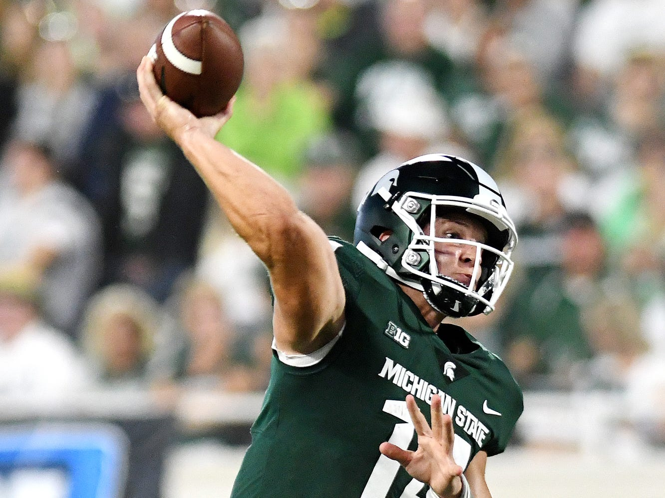Michigan State's Brian Lewerke throws a pass during the second quarter on Friday, Aug. 31, 2018, at Spartan Stadium in East Lansing.