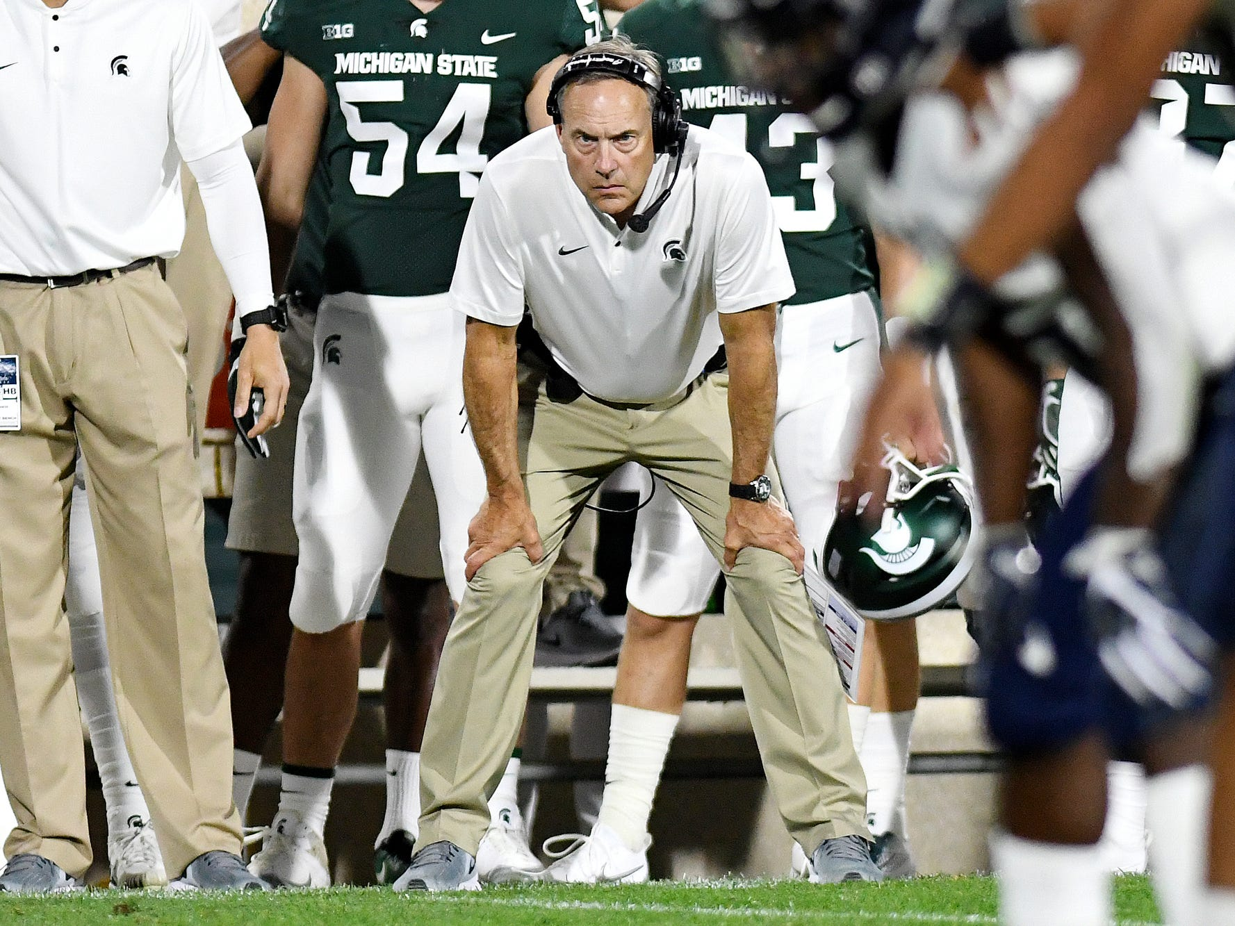 Michigan State's head coach Mark Dantonio looks on before Utah State snaps the ball during the third quarter on Friday, Aug. 31, 2018, at Spartan Stadium in East Lansing.
