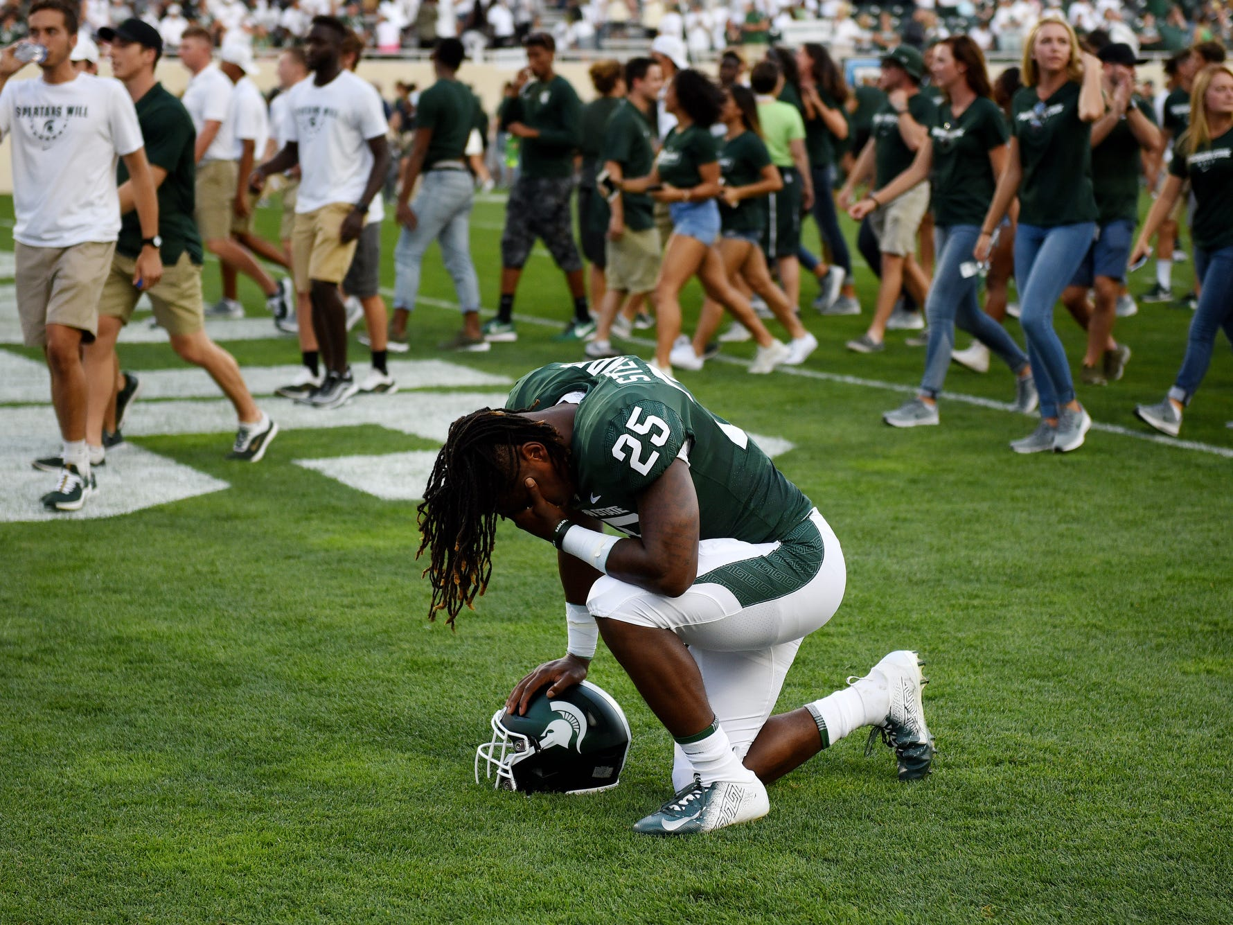 Michigan State's Darrell Stewart Jr. takes time alone in the end zone before the Spartans' game against Utah State on Friday, Aug. 31, 2018, at Spartan Stadium in East Lansing.
