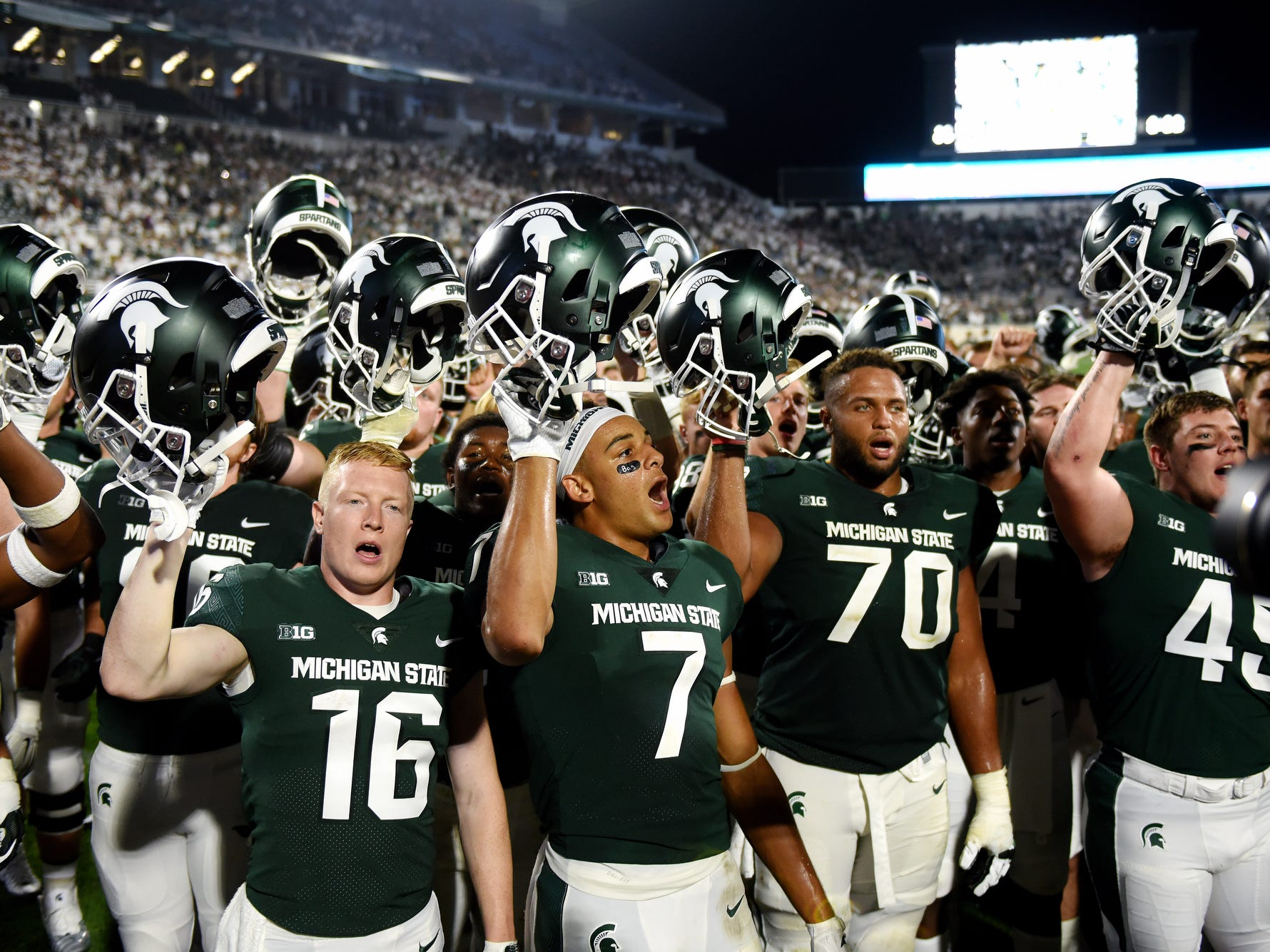 Michigan State sings the fight song after defeating Utah State on Friday, Aug. 31, 2018, at Spartan Stadium in East Lansing.