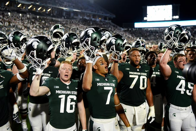 Michigan State sings the fight song after defeating Utah State in the 2018 opener.