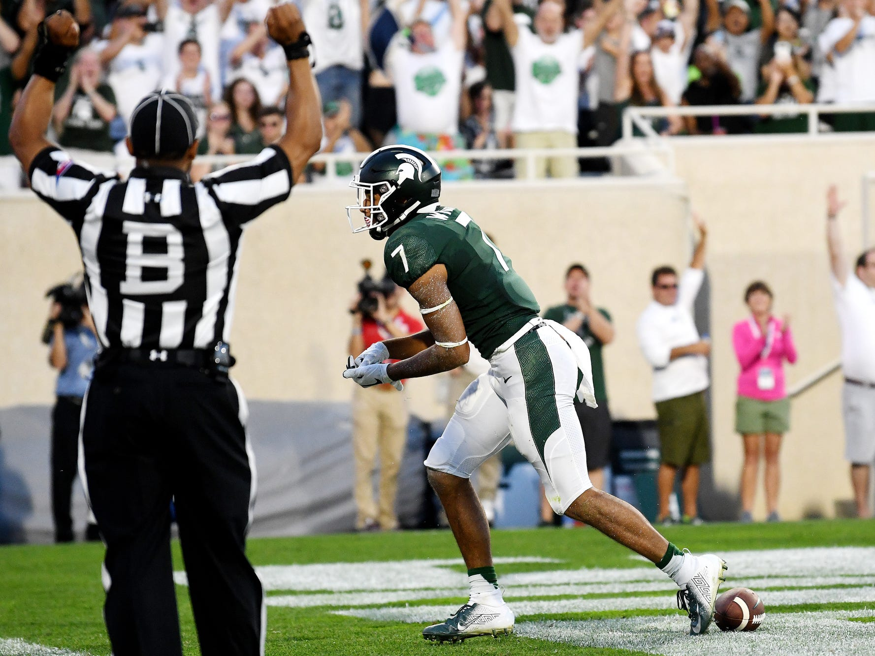 Michigan State's Cody White celebrates a touchdown during the second quarter on Friday, Aug. 31, 2018, at Spartan Stadium in East Lansing.