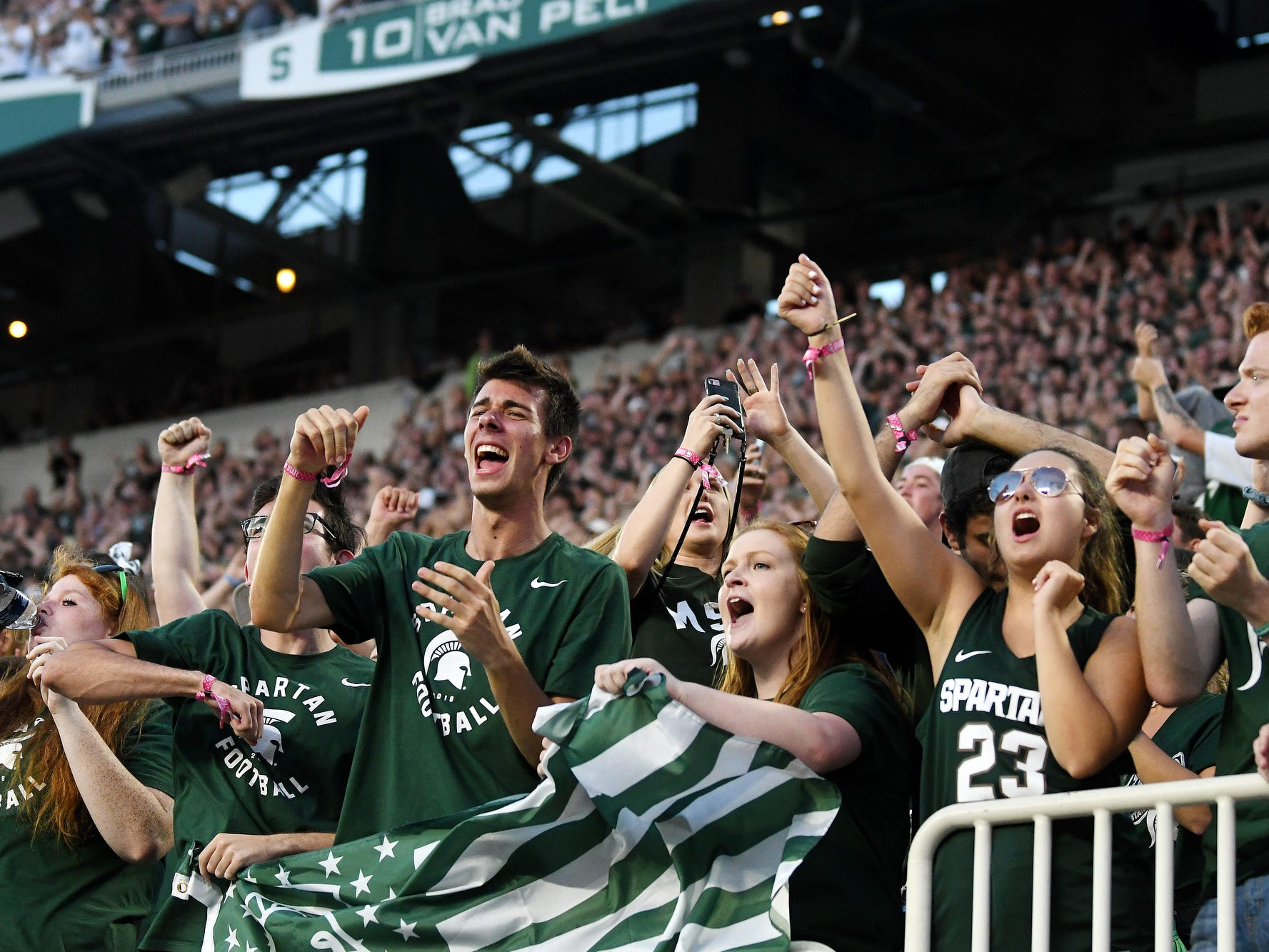 Michigan State fans celebrate after Cody White's touchdown during the second quarter on Friday, Aug. 31, 2018, at Spartan Stadium in East Lansing.