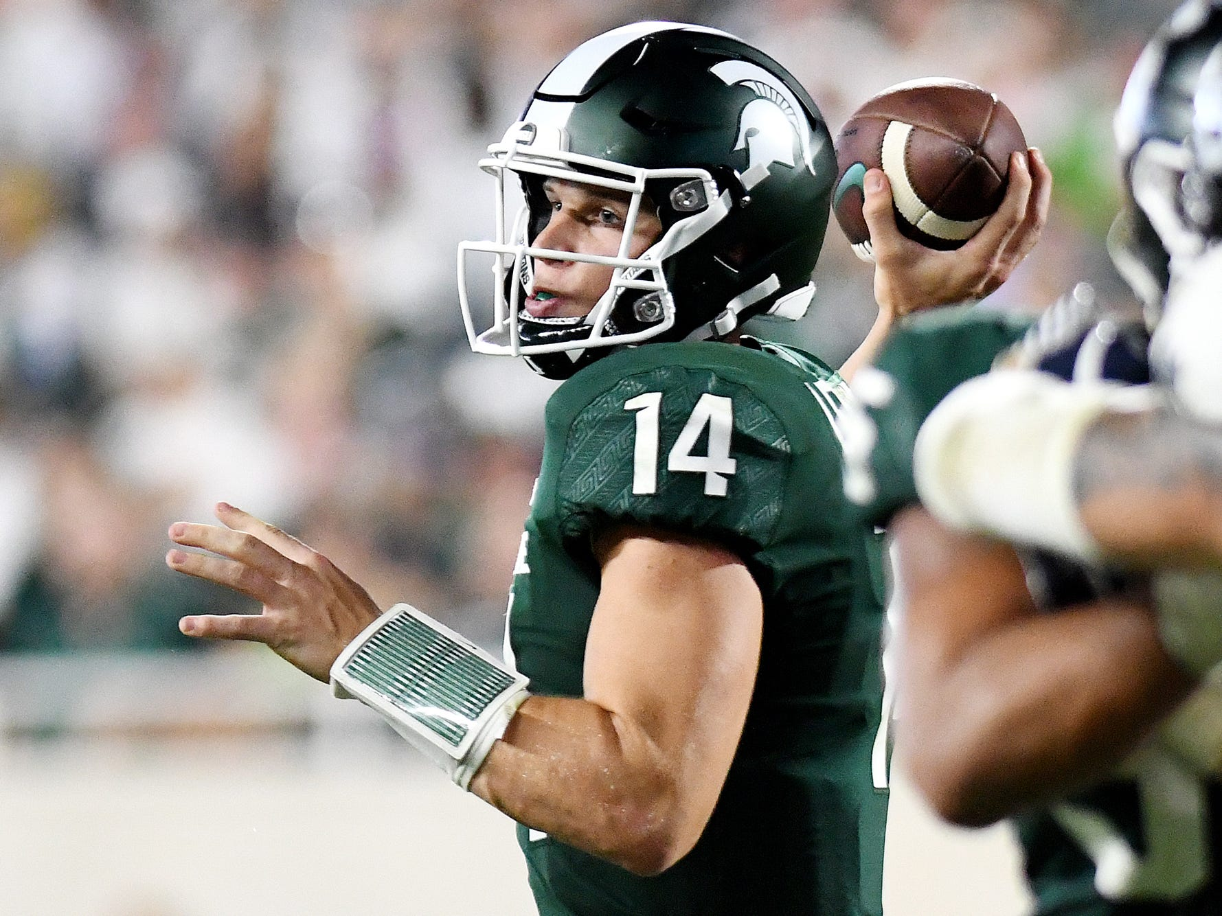 Michigan State's Brian Lewerke passes the ball during the fourth quarter on Friday, Aug. 31, 2018, at Spartan Stadium in East Lansing.