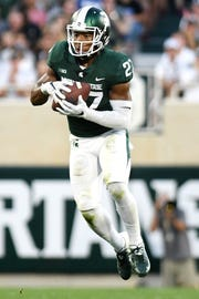 Michigan State's Khari Willis picks off a pass during the second quarter on Friday, Aug. 31, 2018, at Spartan Stadium in East Lansing.