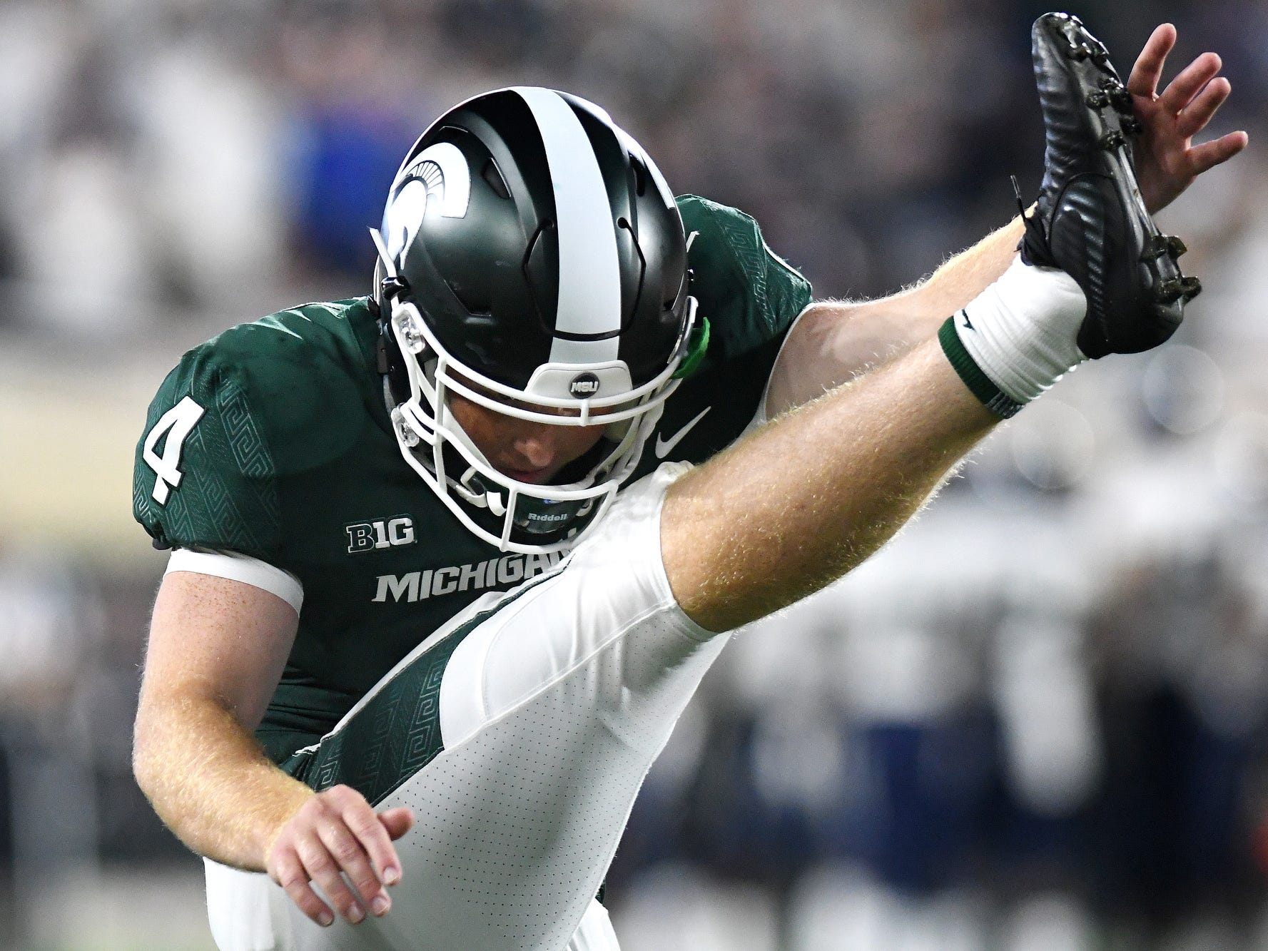 Michigan State's Matt Coghlin warms up his leg during a timeout in the fourth quarter on Friday, Aug. 31, 2018, at Spartan Stadium in East Lansing.