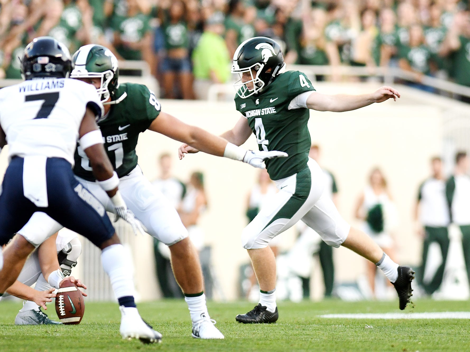 Michigan State's Matt Coghlin, right, kicks a field goal during the first quarter on Friday, Aug. 31, 2018, at Spartan Stadium in East Lansing.