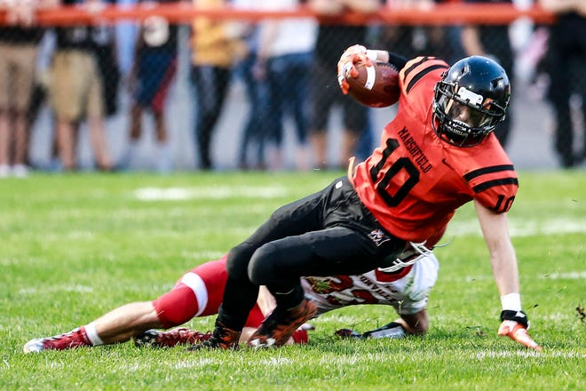 Marshfield's running back Caden Pearce(10), front, slips on the ground while Hortonville's Dylan Schmidt(33) attempts to tackle Friday, August 31, 2018, at Beell Stadium in Marshfield, Wis. T'xer Zhon Kha/USA TODAY NETWORK-Wisconsin