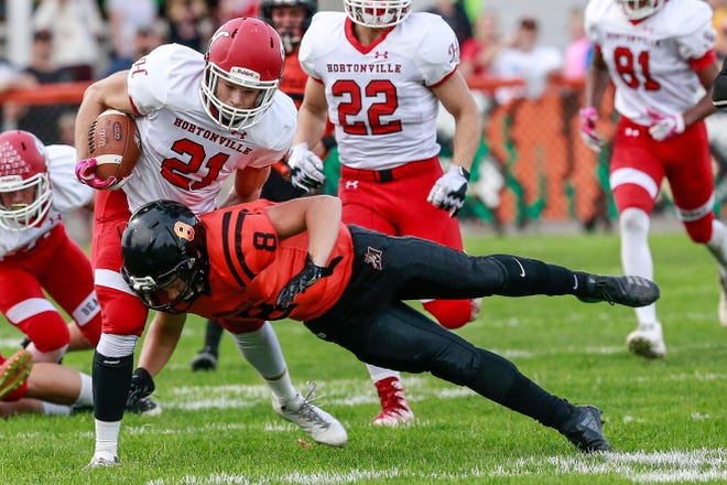Hortonville's Braden Valafskey(21), left, gets a shoulder hit by Marshfield's Mason Coffren(8) Friday, August 31, 2018, at Beell Stadium in Marshfield, Wis. T'xer Zhon Kha/USA TODAY NETWORK-Wisconsin