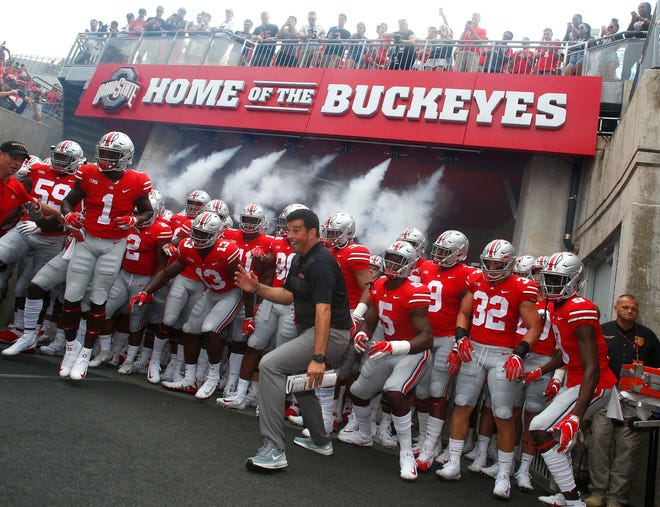 Acting head coach Ryan Day leads the Ohio State Buckeyes out of the tunnel for Saturday's season opener against Oregon State.