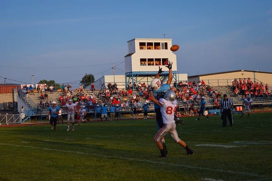 Ridgedale's Grant Park reaches up for one of his two interceptions on Friday night against Vanlue in a non-league football game