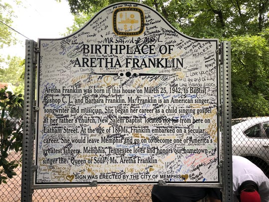 A marker outside the home of the Aretha Franklin birthplace, autographed by hordes of fans who have visited the site.