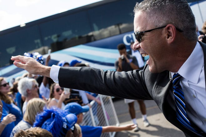 University of Memphis coach Mike Norvell greats fans at the start of Tiger Walk before the game against Mercer on Sept. 1, 2018, at the Liberty Bowl Memorial Stadium.