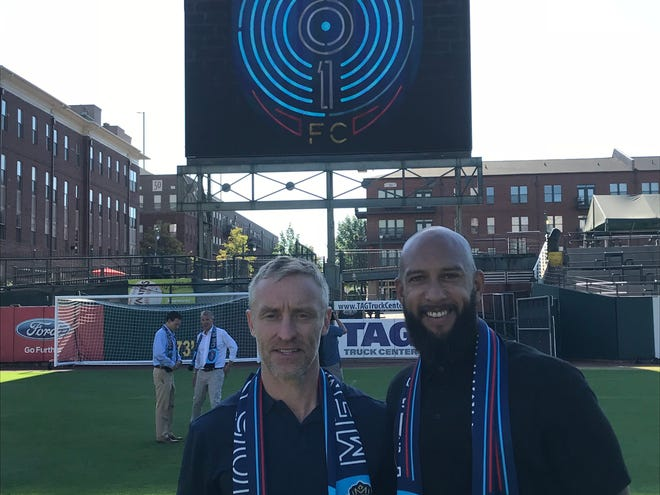 Sporting director Andrew Bell and soccer legend Tim Howard pose for a photo at Autozone Park, newly transformed into a soccer pitch, as they reveal the new Memphis 901 FC name and logo.